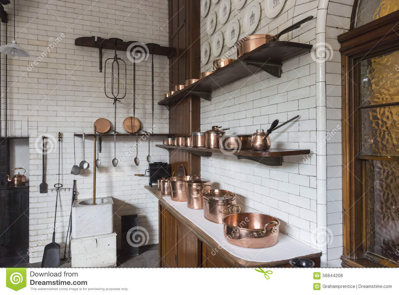Old Fashioned Kitchen Copper Pots Pans Saucepans And Utensils In An Old Fashioned