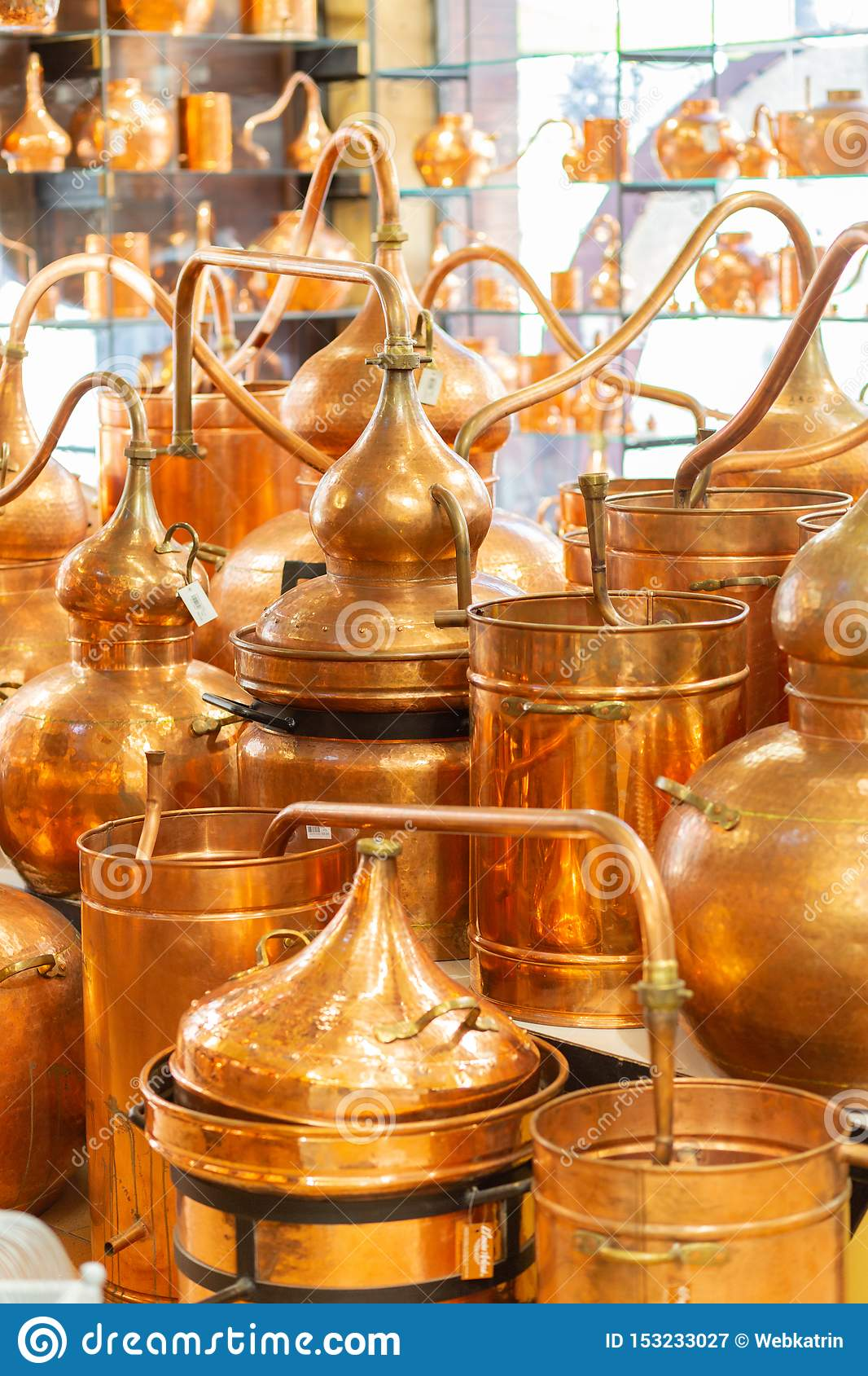Copper ware, serpentine and jugs on the shop window in the store.