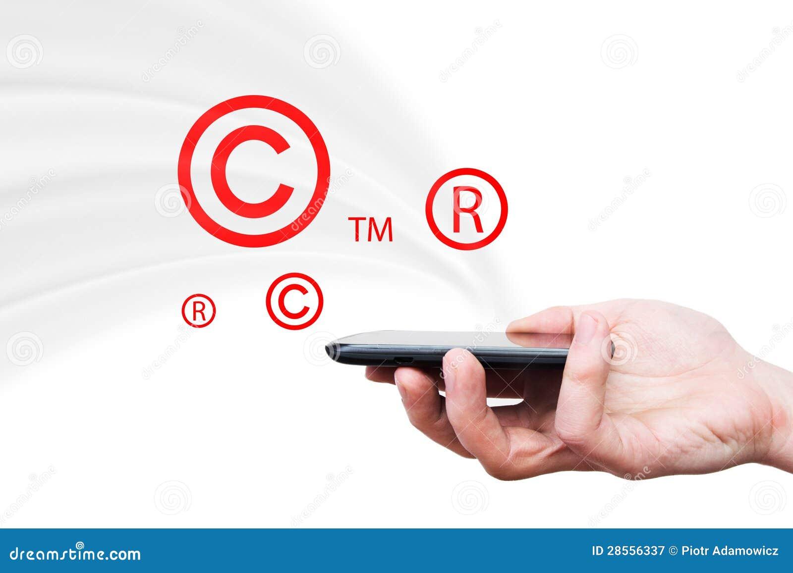 Copyright trademark symbols flying from smartphone stock copyright trademark symbols flying from smartphone buycottarizona