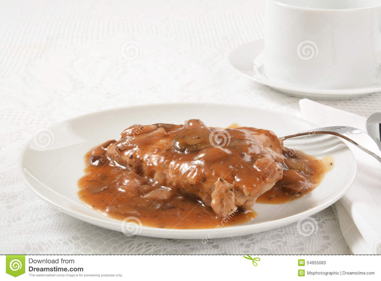 Grilled chicken breast smothered in a mushroom, wine gravy sauce.
