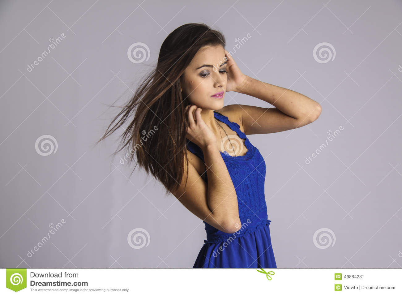 Coquettish girl with blowing hair