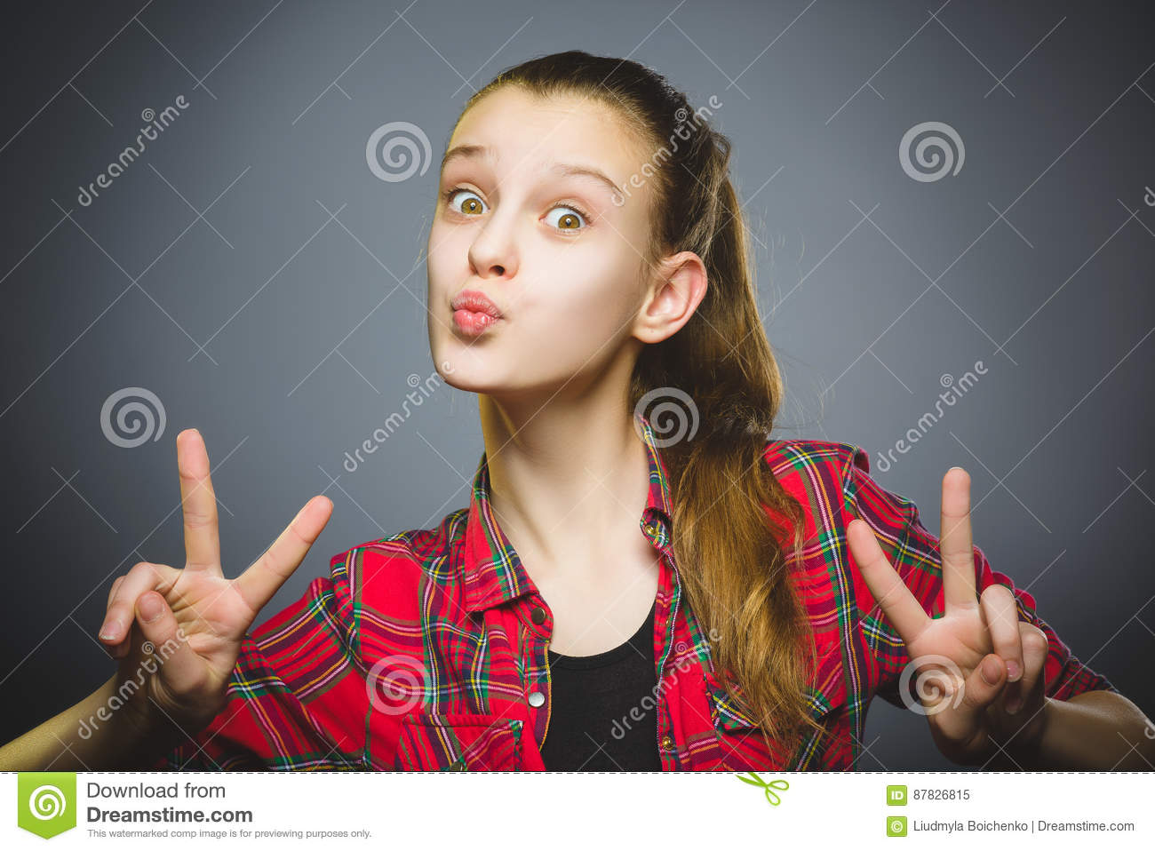 Coquettish girl. Closeup Portrait handsome teen smiling isolated on grey