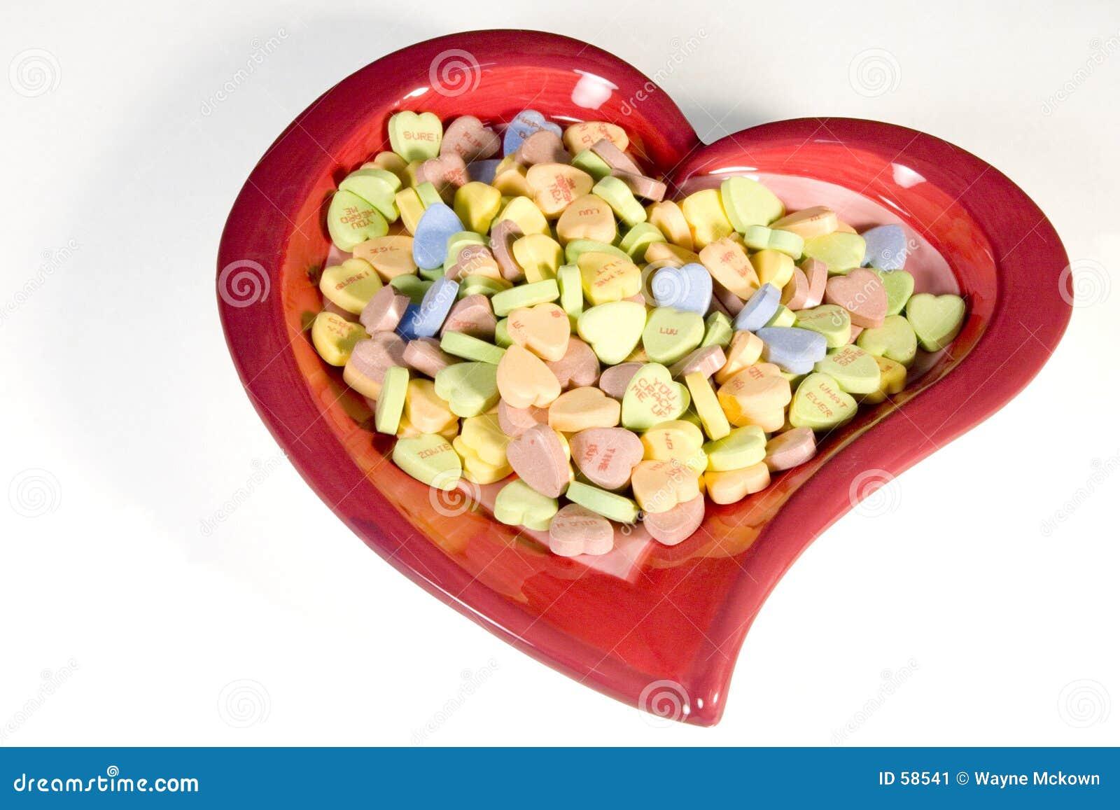 Coração completamente dos doces