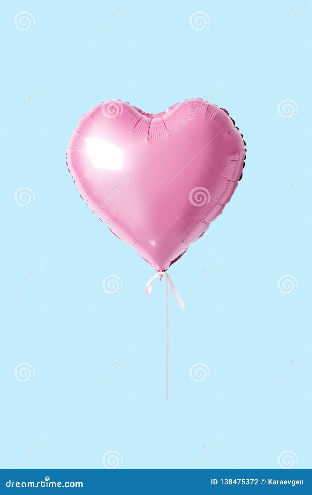 Coração cor-de-rosa balão dado forma no fundo brilhante Conceito mínimo do amor