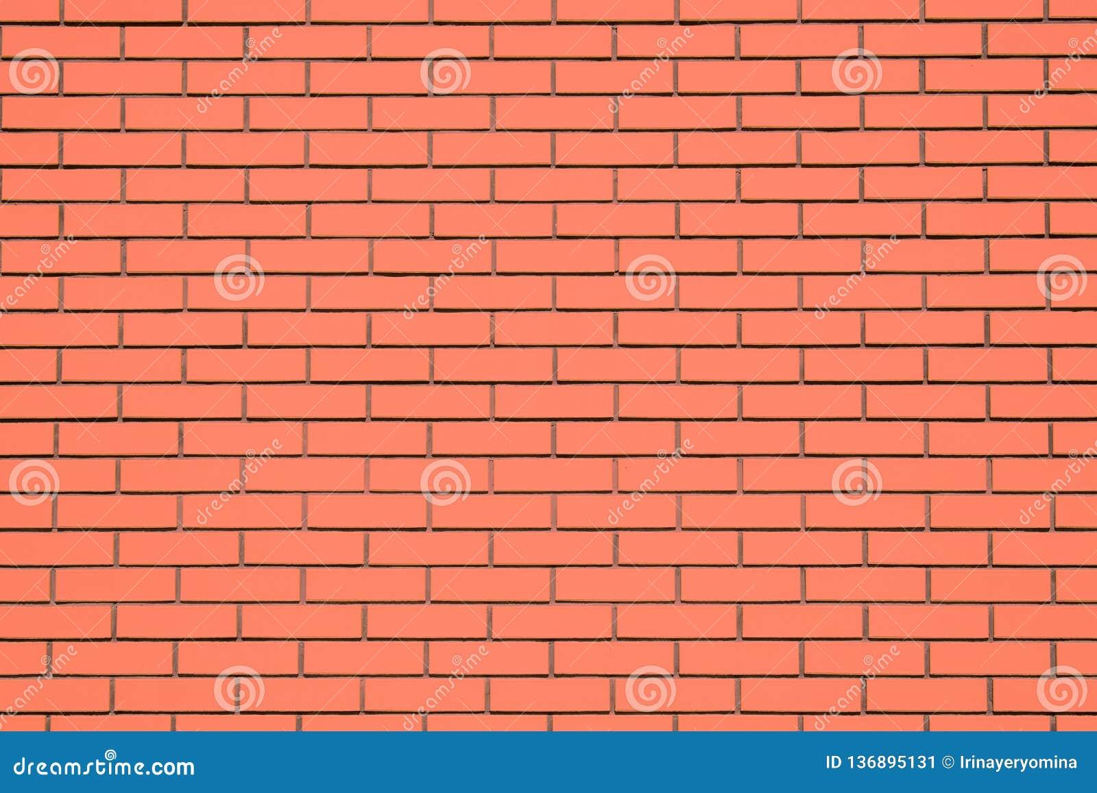 Coral brick wall background. Living Coral textural brick wall, color