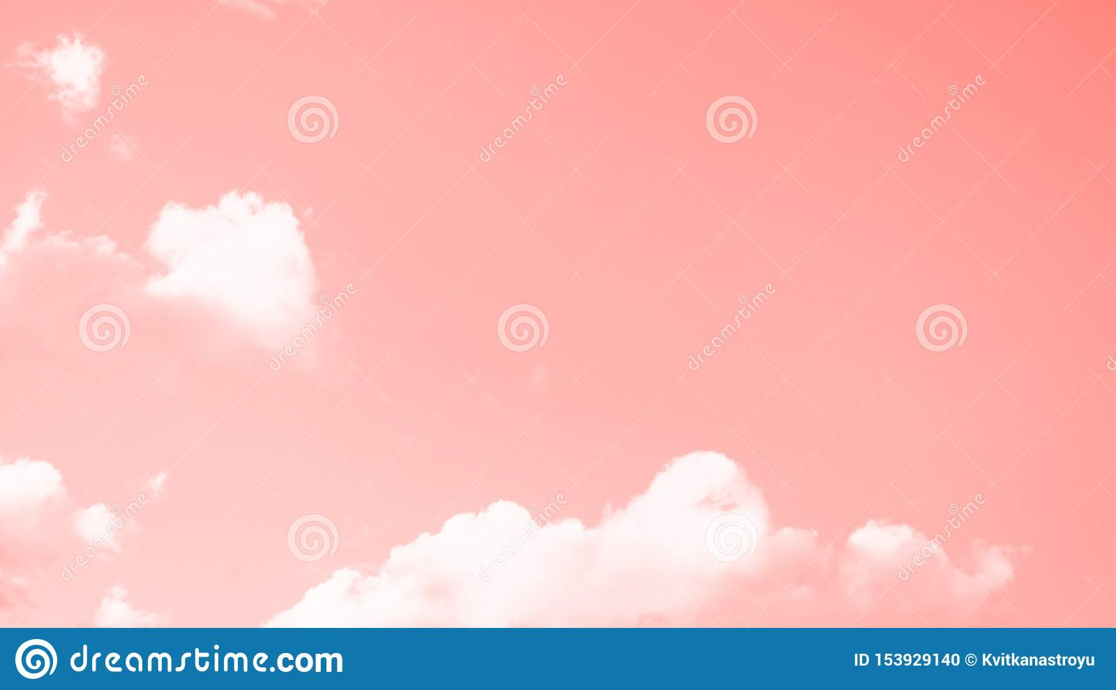Coral color sky background with small white clouds. 16:9 panoramic format