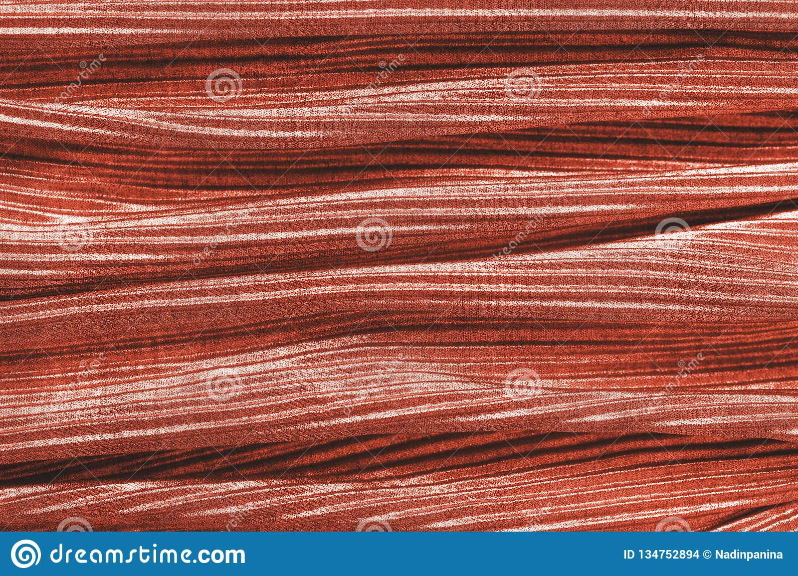 Coral colored fabric texture. Concept of color of 2019