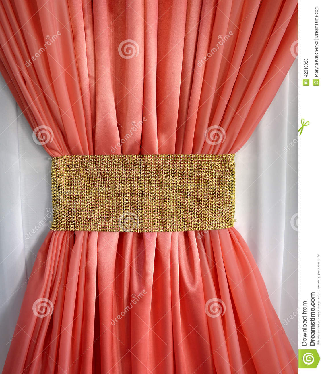 Bright coral ruffled curtain in the form of a bow gleaming gold belt ...