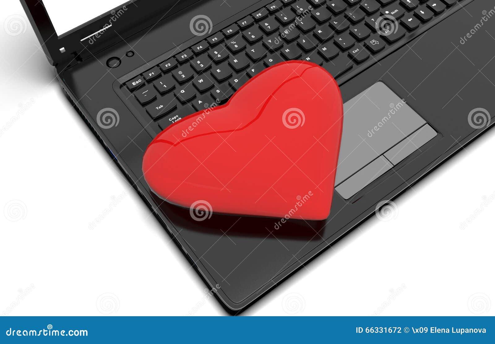 Corazón rojo con un ordenador portátil