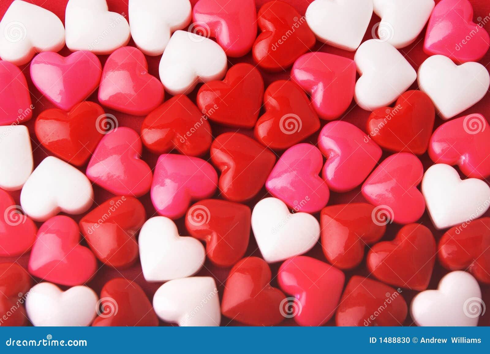 Corazones de la tarjeta del día de San Valentín del caramelo