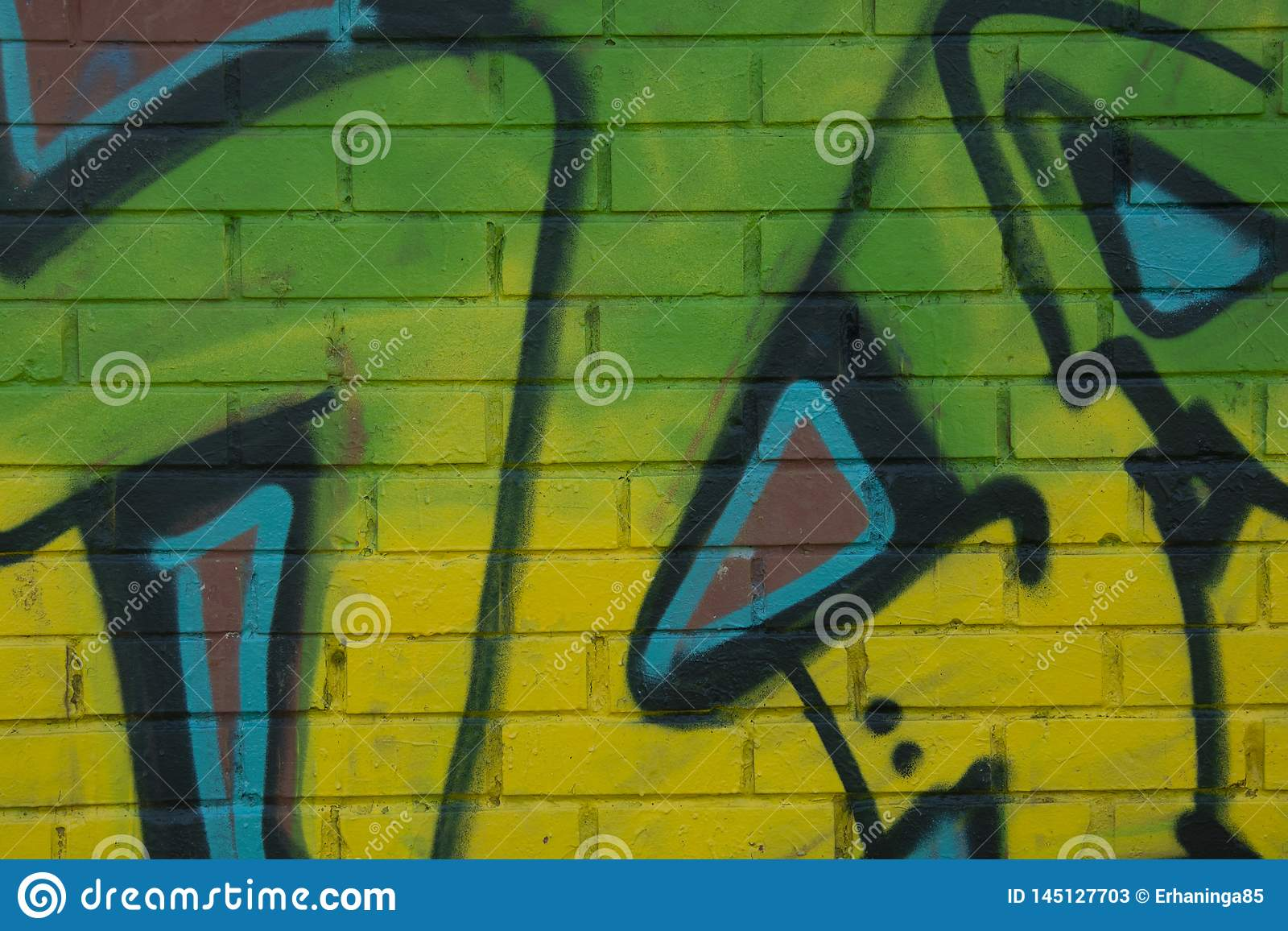 Corby, United Kingdom. April 4, 2019 - Green graffiti lettering on brich wall. Neon green piece of graffiti. Abstract background