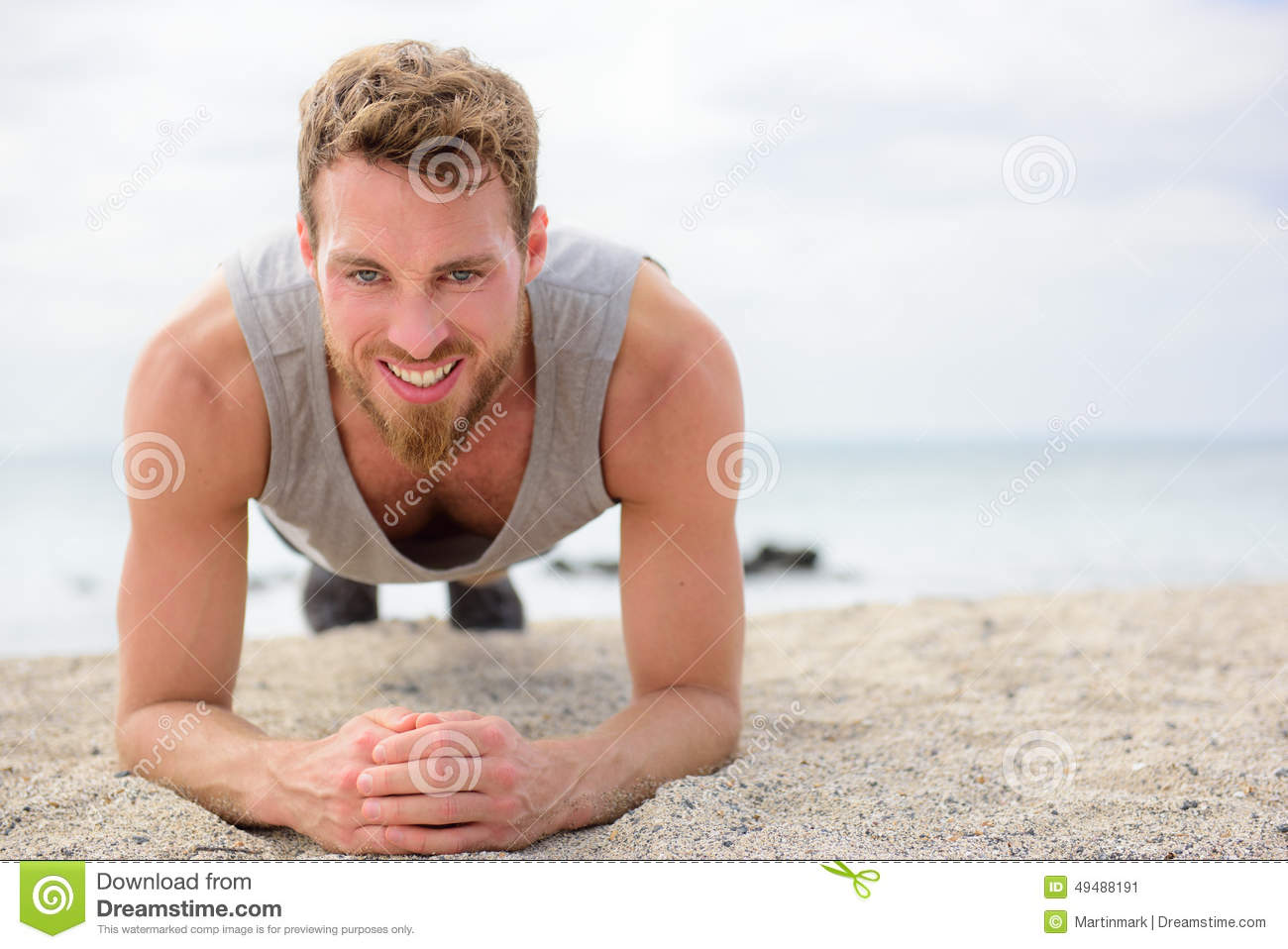 Core exercise - fitness man doing plank outside