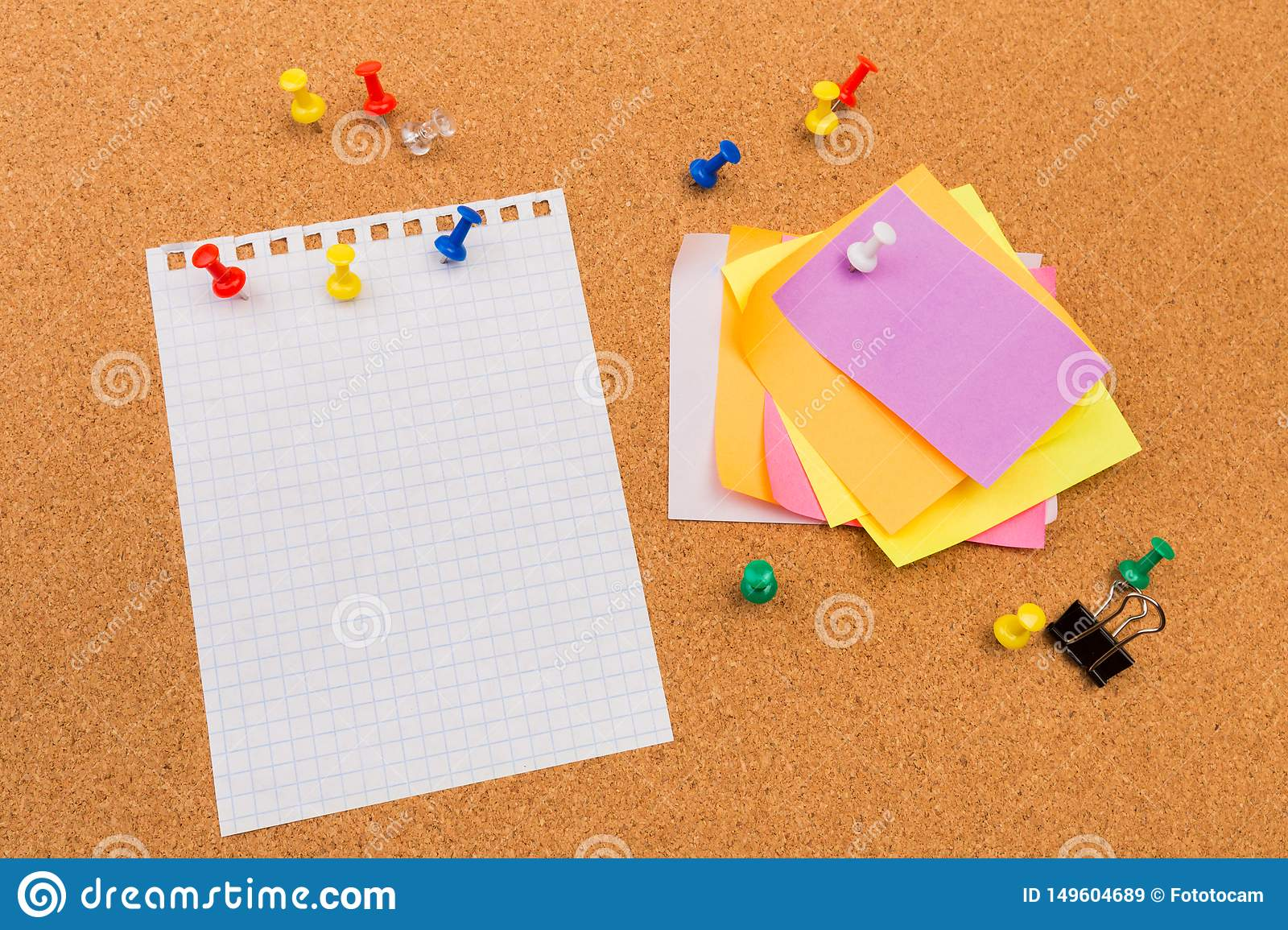 Cork board with pinned colored blank notes - Image