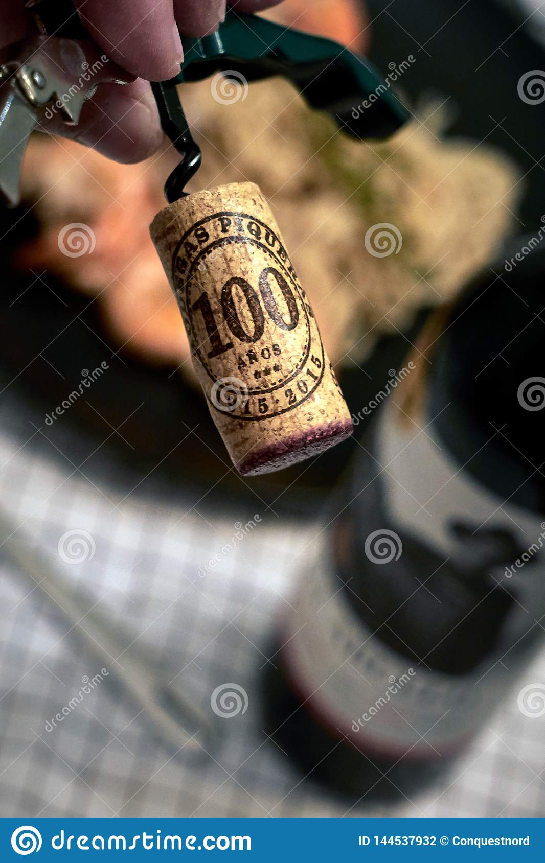 Cork screwed from the bottle of red wine