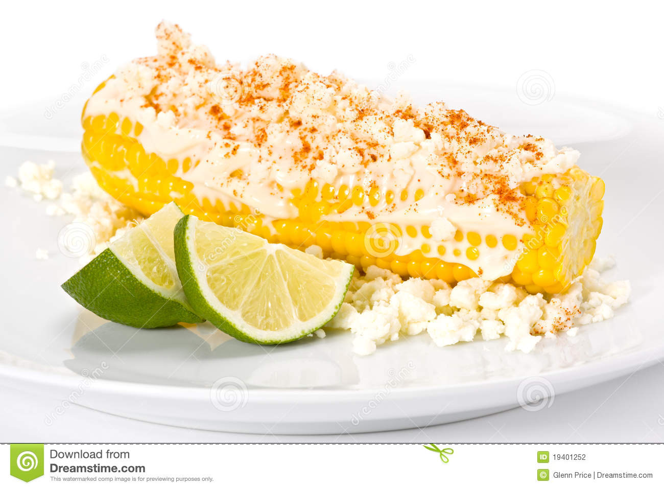 Fresh yellow corn on the cob with mayonnaise, cotija cheese, and ...