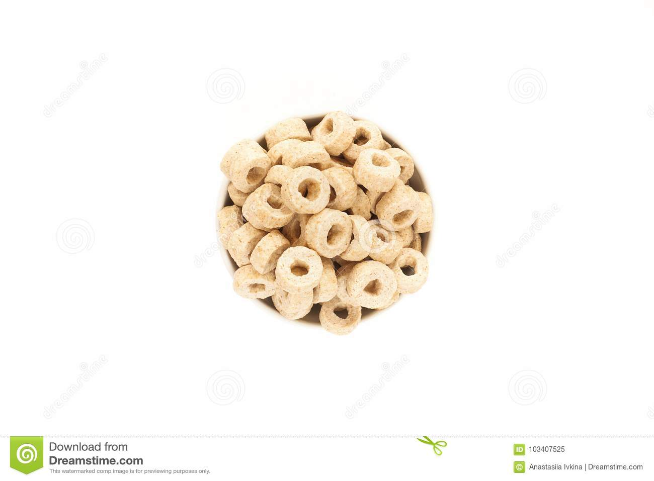 Corn Flakes in the form Rings in the Bowl Isolated Top View