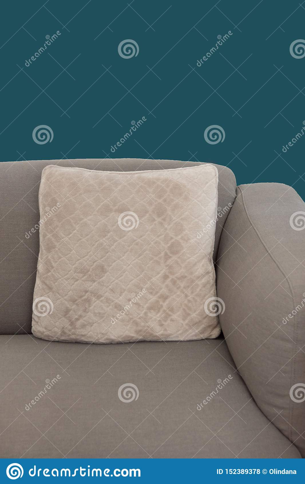Corner Fragment Of Beige Grey Upholstered Couch With Velour