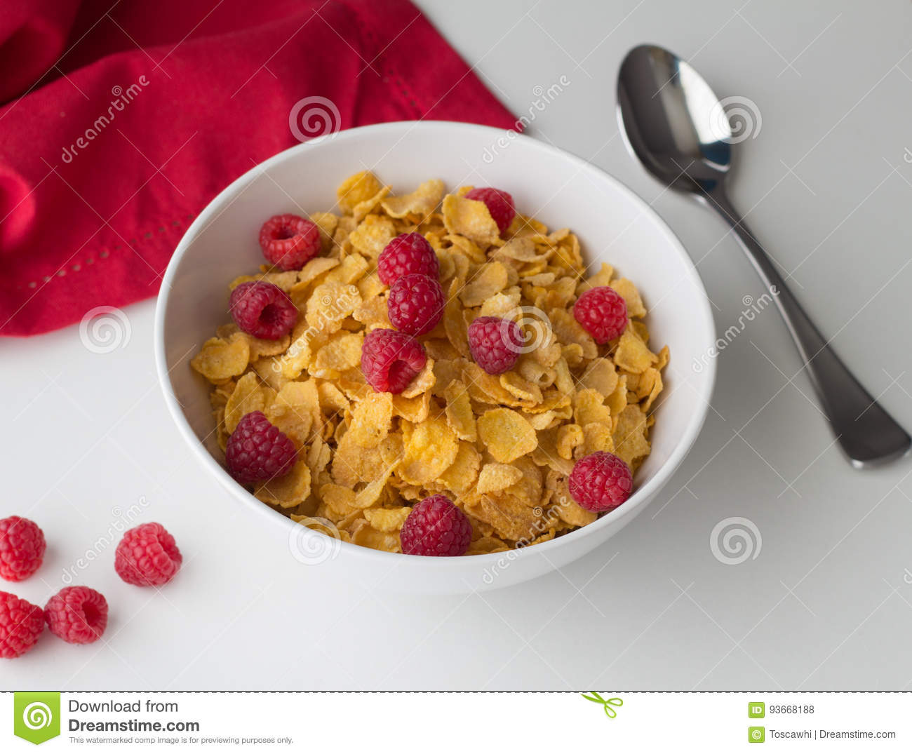 Cornflakes Breakfast Cereal With Raspberries In Bowl On ...