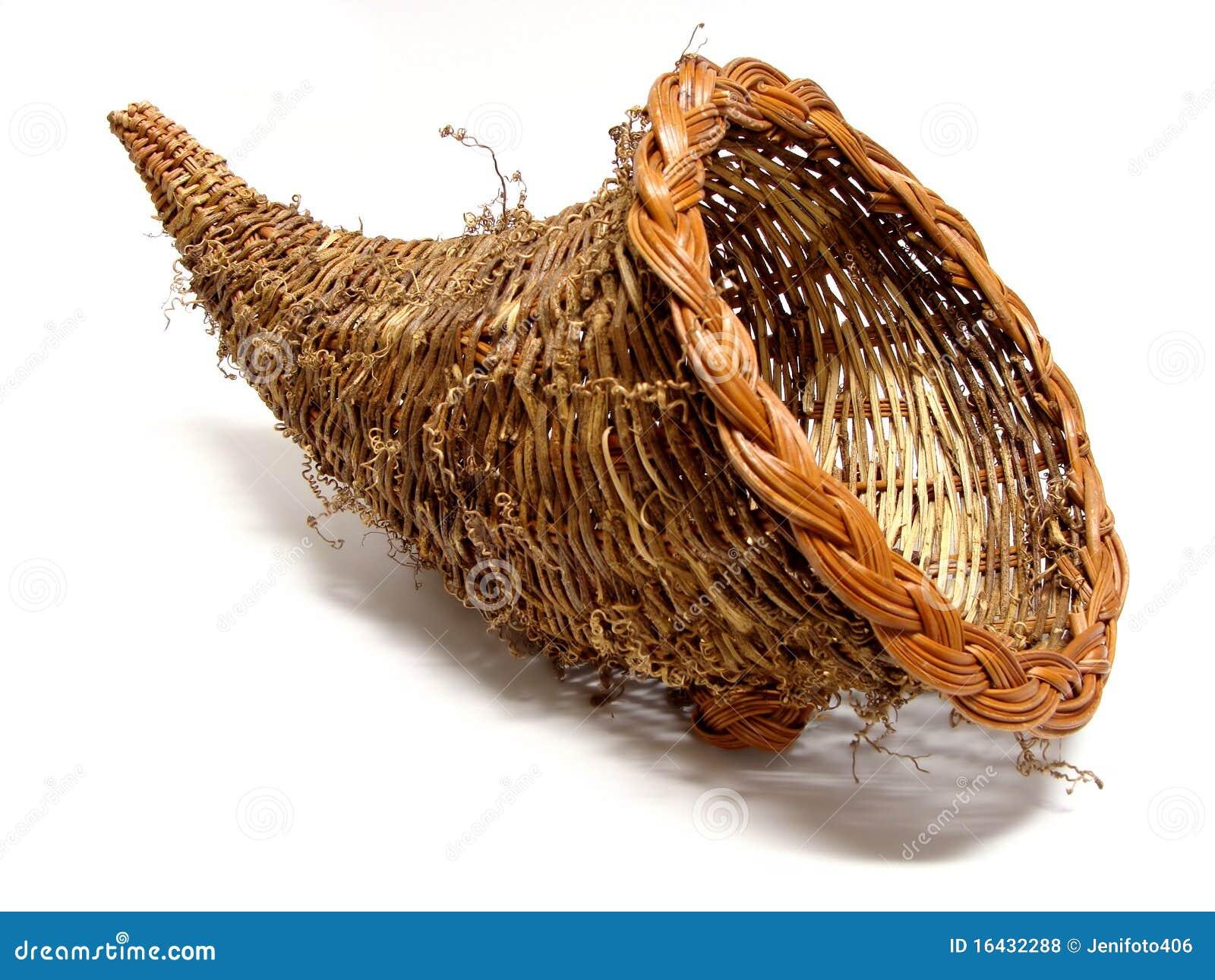 Empty cornucopia basket for thanksgiving isolated on a white ...