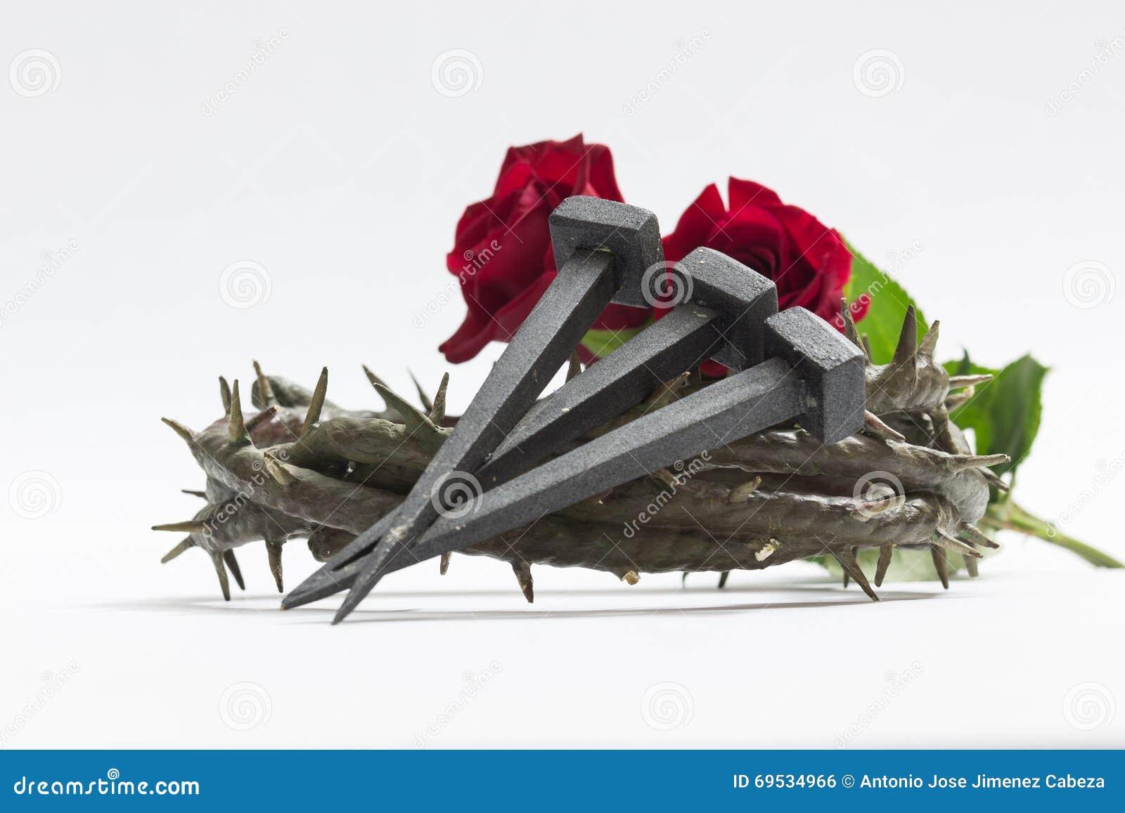 Coroa de Jesus Christ de espinhos, de pregos e de duas rosas