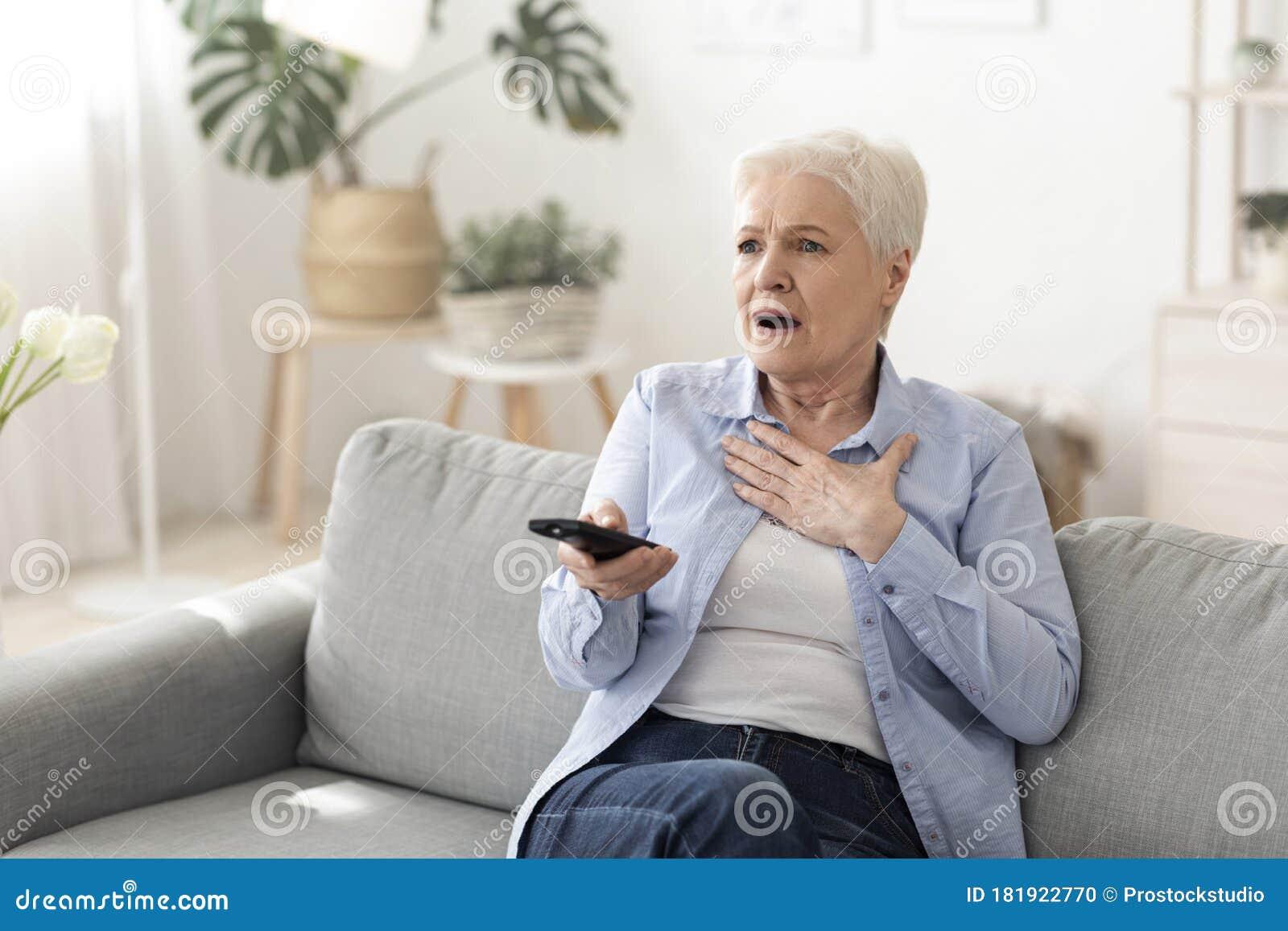 Seniors Enjoying Television Stock Photo - Download Image