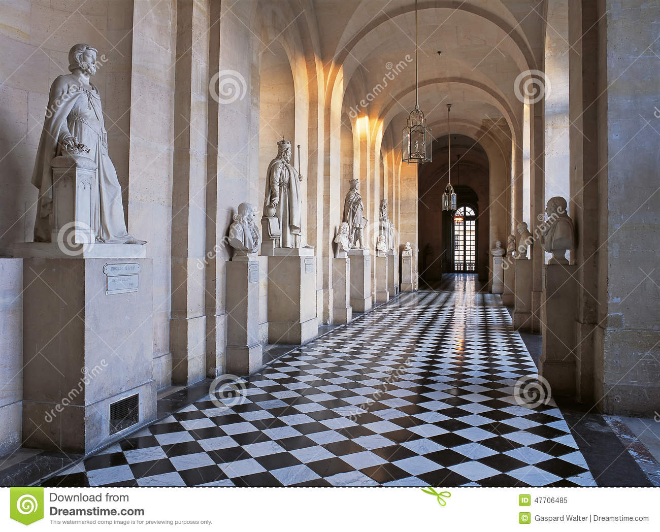 Corridor With Marble Sculptures And Marble Floor At