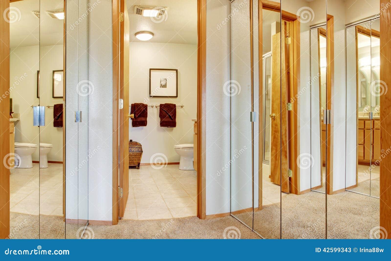 Corridor With Mirror Door Closets And Bathroom View Stock