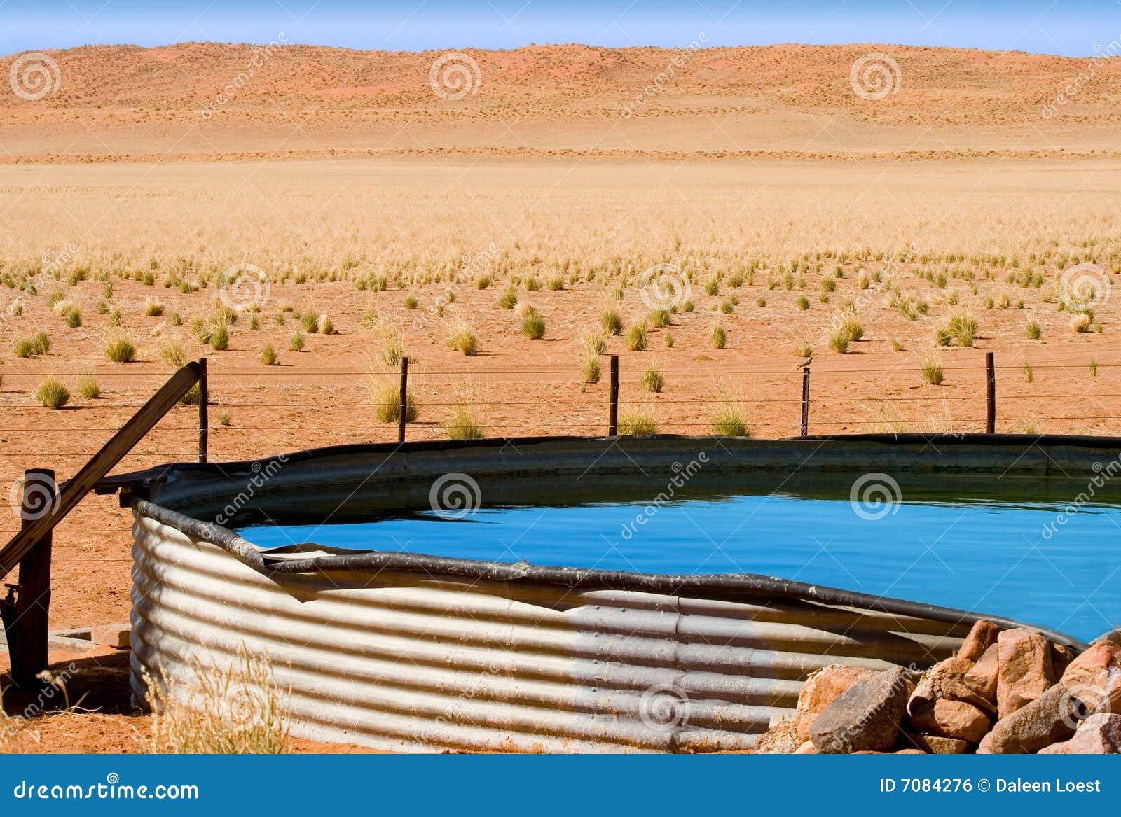 Corrugated Iron Dam On Desert Farm Royalty Free Stock