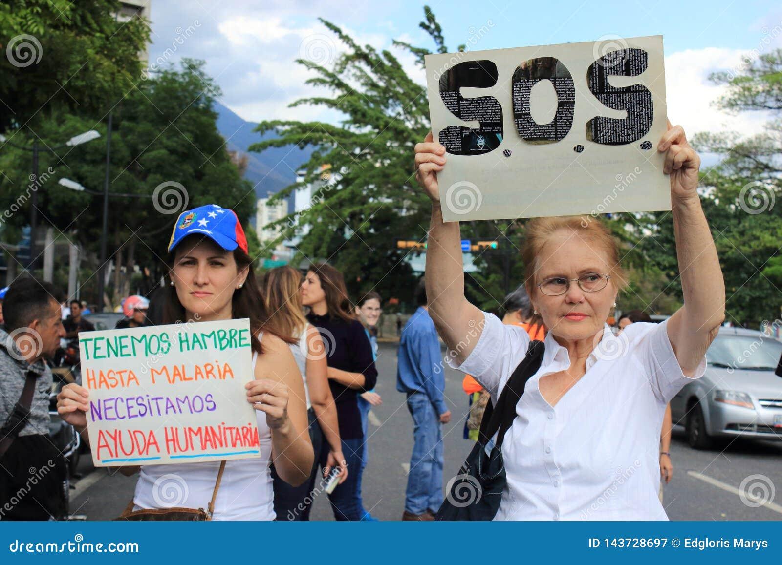 Cortes de energia da Venezuela: Os protestos estoiram na Venezuela sobre o escurecimento