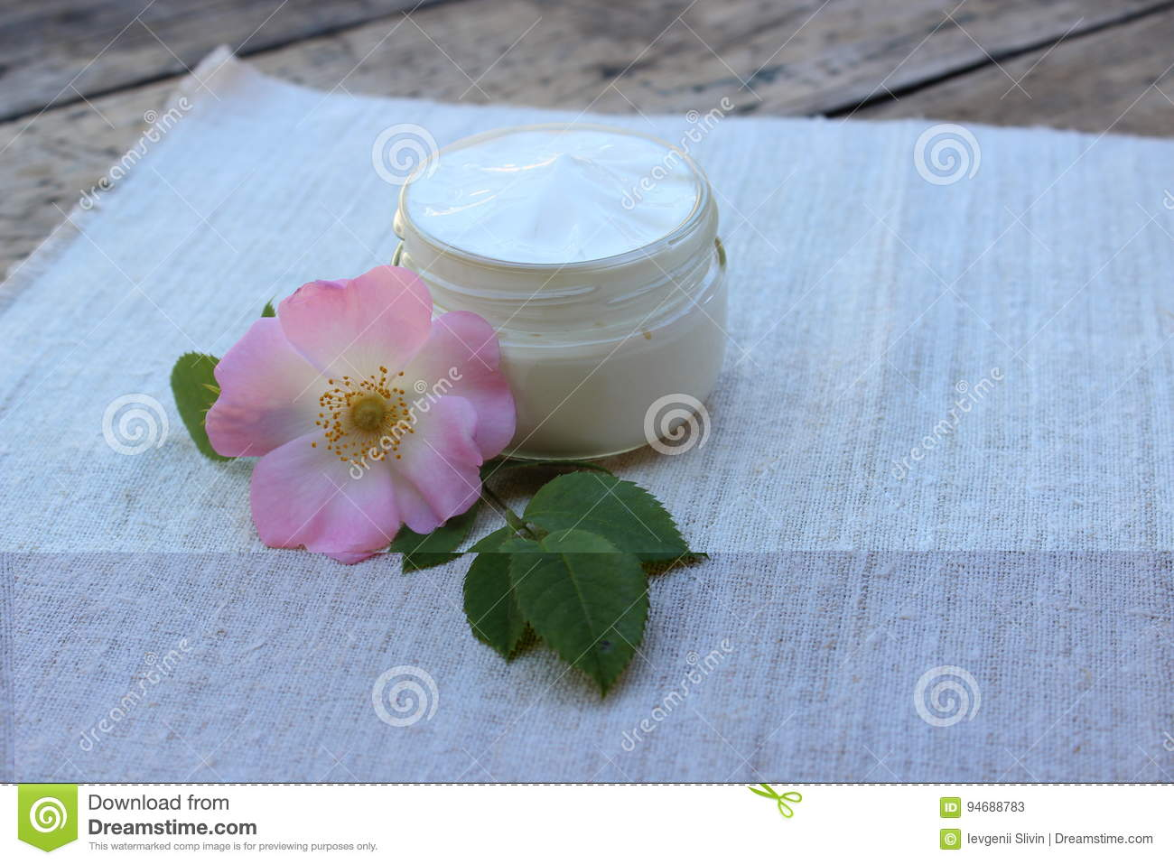 Cosmetic cream with rose hip flower
