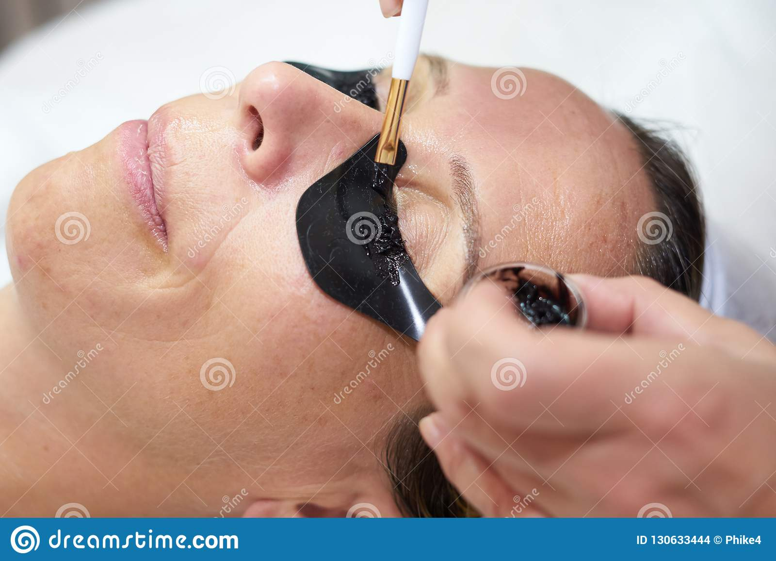 Cosmetician Coloring Eyelashes Stock Photo - Image of beautician ...