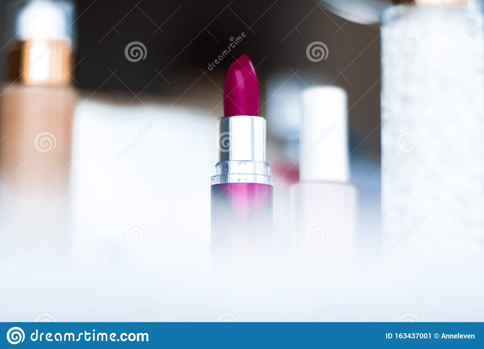 Cosmetics, makeup products on dressing vanity table, lipstick, foundation base, nailpolish and eyeshadows for luxury beauty and
