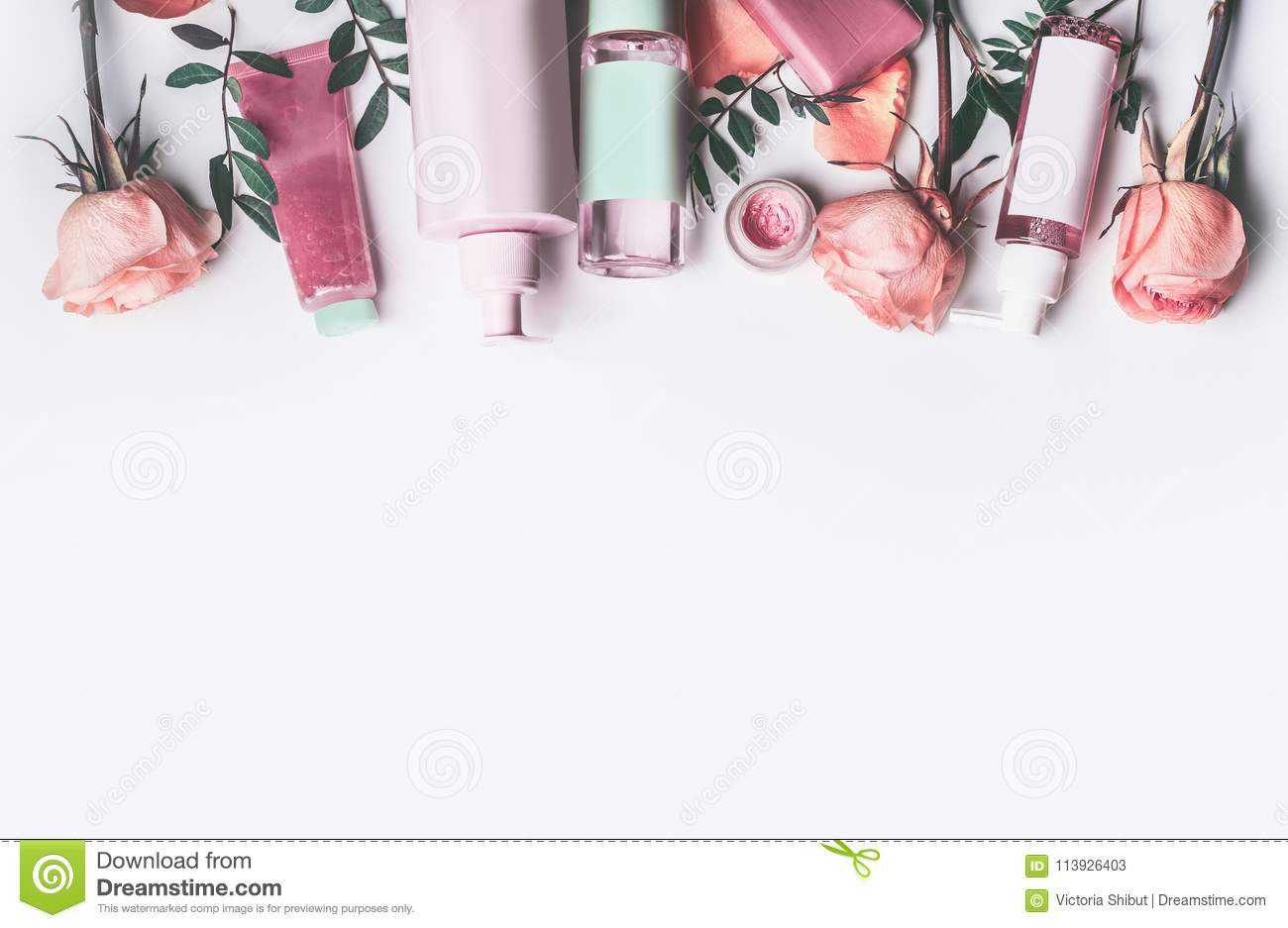 Cosmetics set with Rose essential oils: toner, serum, essence, moisturizer and and others on white