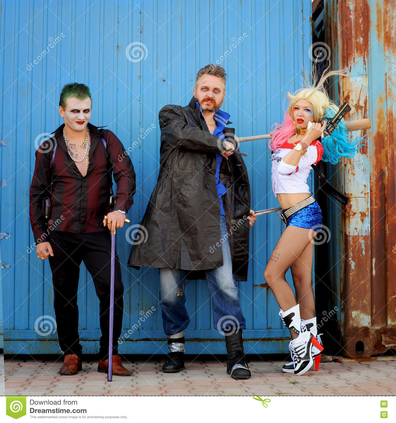 Cosplayer girl in Harley Quinn costume and cosplayer men in Joker and Boomerang Editorial Photo