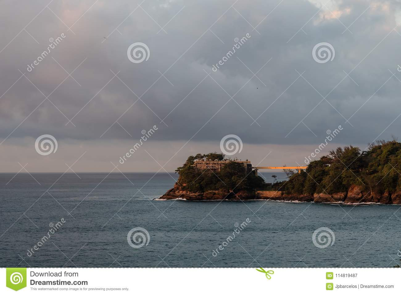Costa Brava island, seen from Joa highway during sunrise, orange light in cloudy morning, Rio de Janeiro, brazil