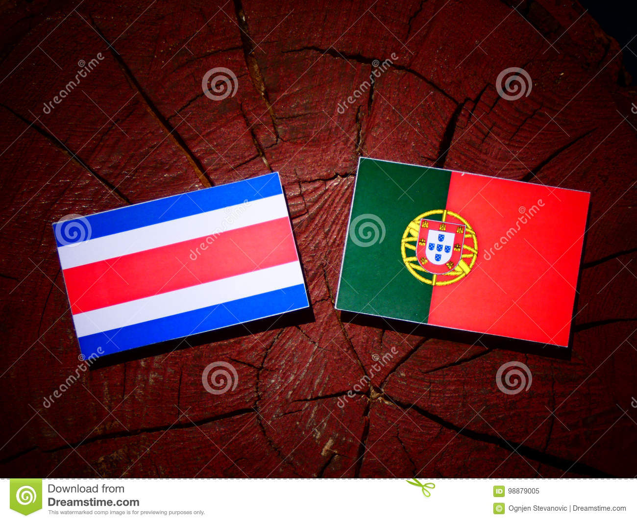 Costa Rican flag with Portuguese flag on a tree stump isolated