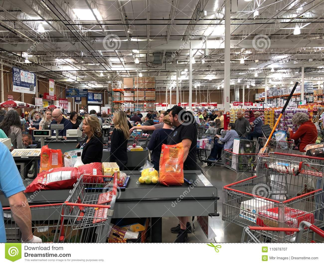 Costco Cashiers Helping People Check Out The Products They Are About Purchase