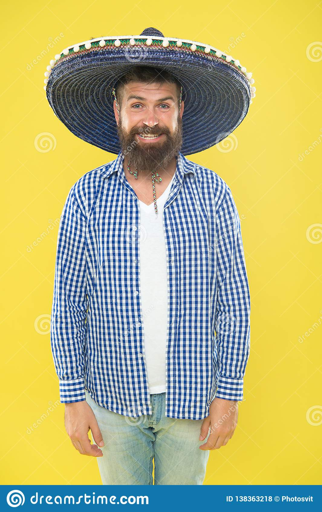 Costume accesory. Bearded man in mexican hat. Mexican man wearing sombrero. Hipster in wide brim hat. Traditional