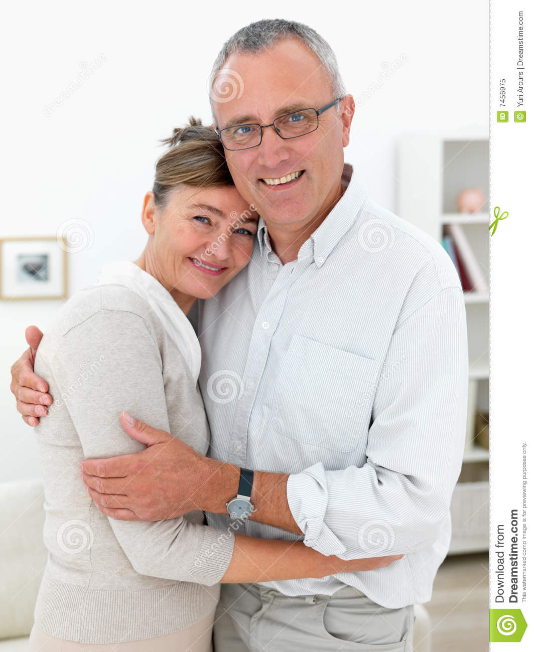 Cosy Old Couple Hugging At Home Stock Image