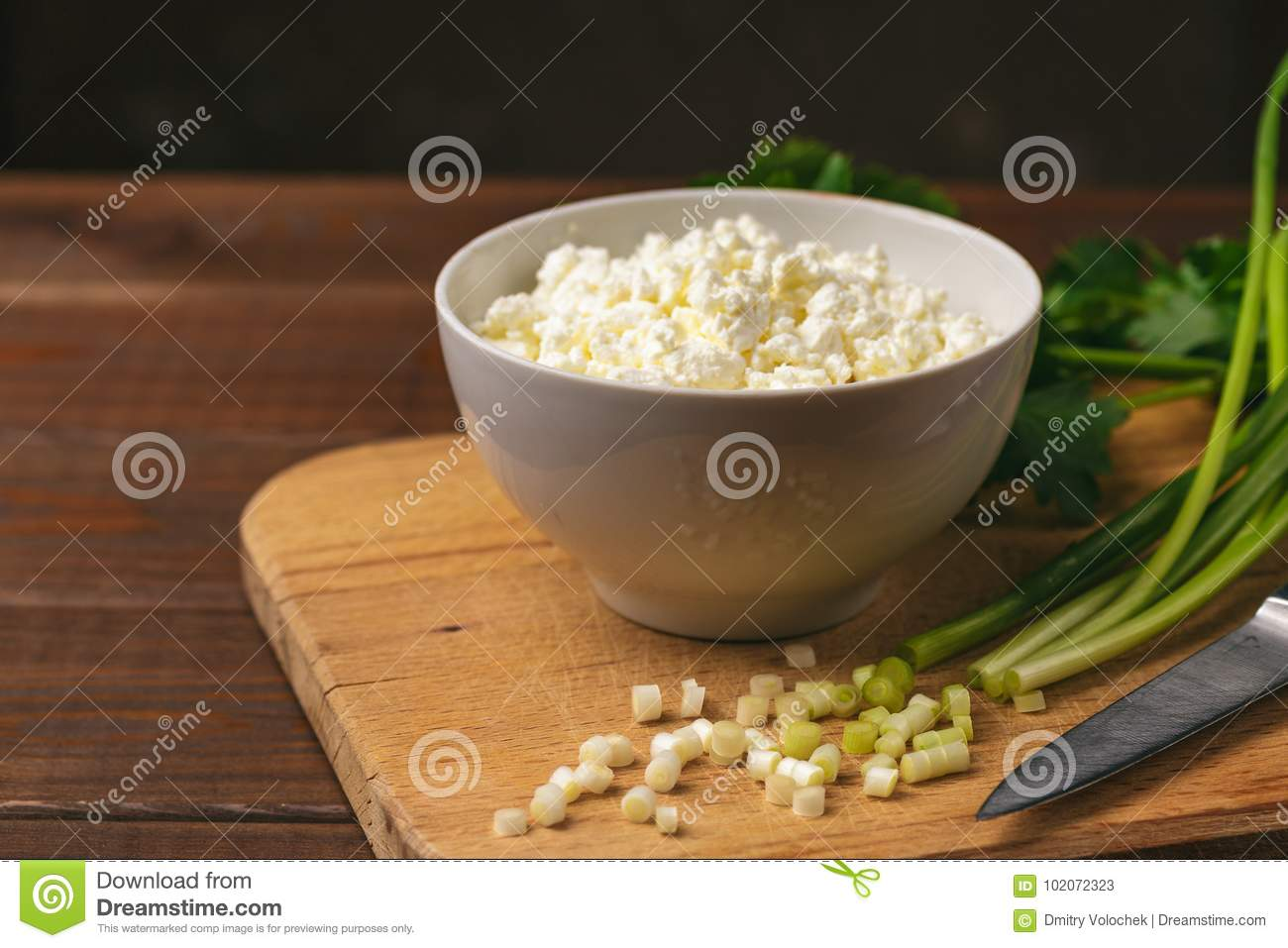 cottage cheese or curd in bowl and fresh green herb as ingredients rh dreamstime com Cottage Cheese Diet Before and After Cottage Cheese and Weight Loss
