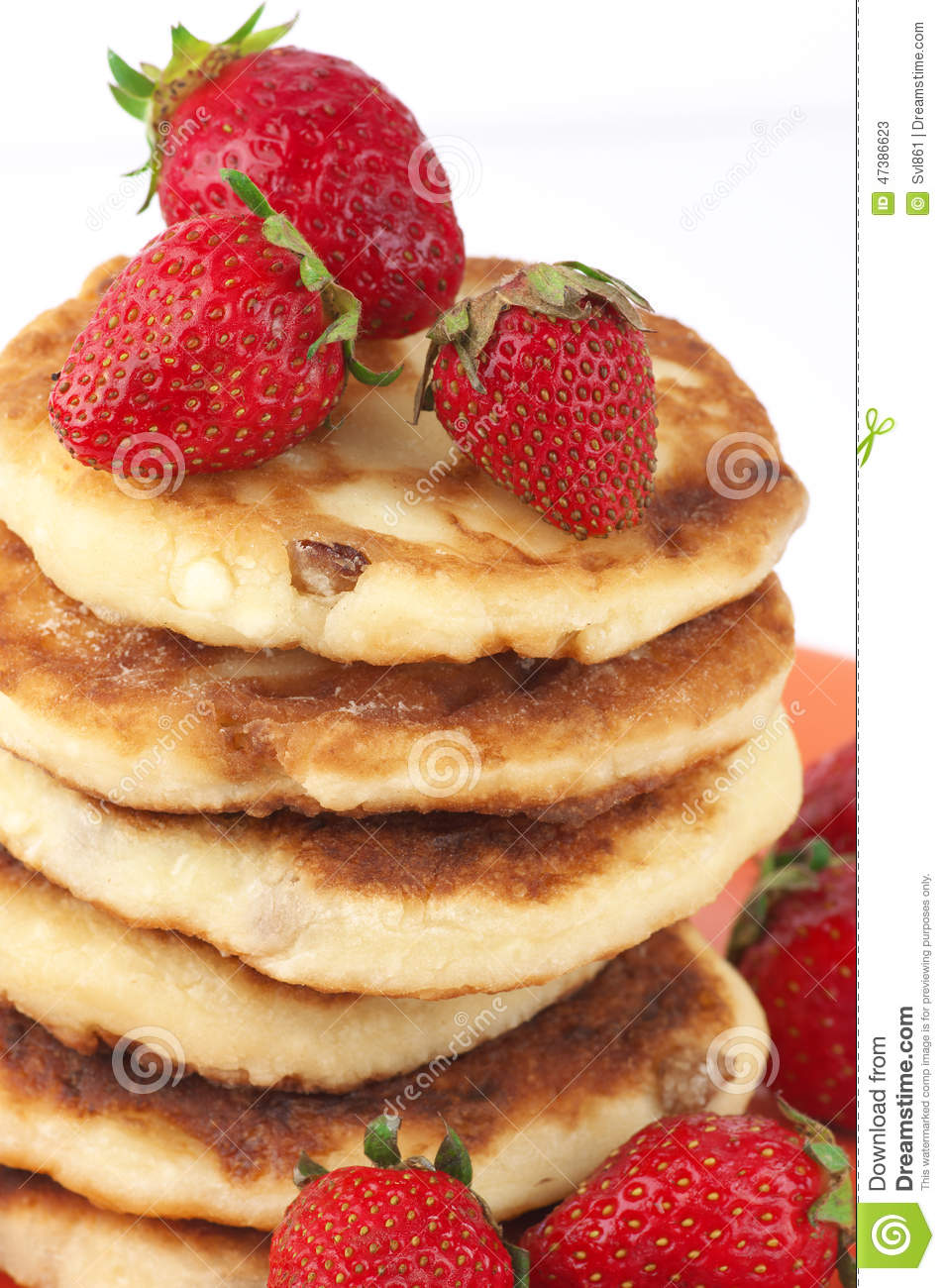 Stack of cottage cheese pancakes with strawberries on white background ...