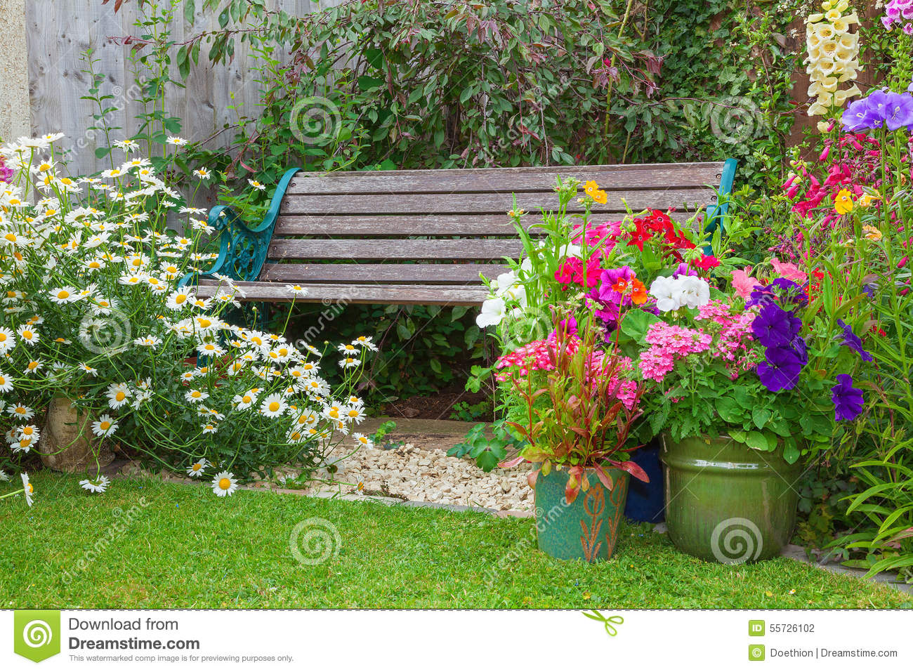 Cottage garden with bench and containers full of flowers - Wooden containers for flowers ...