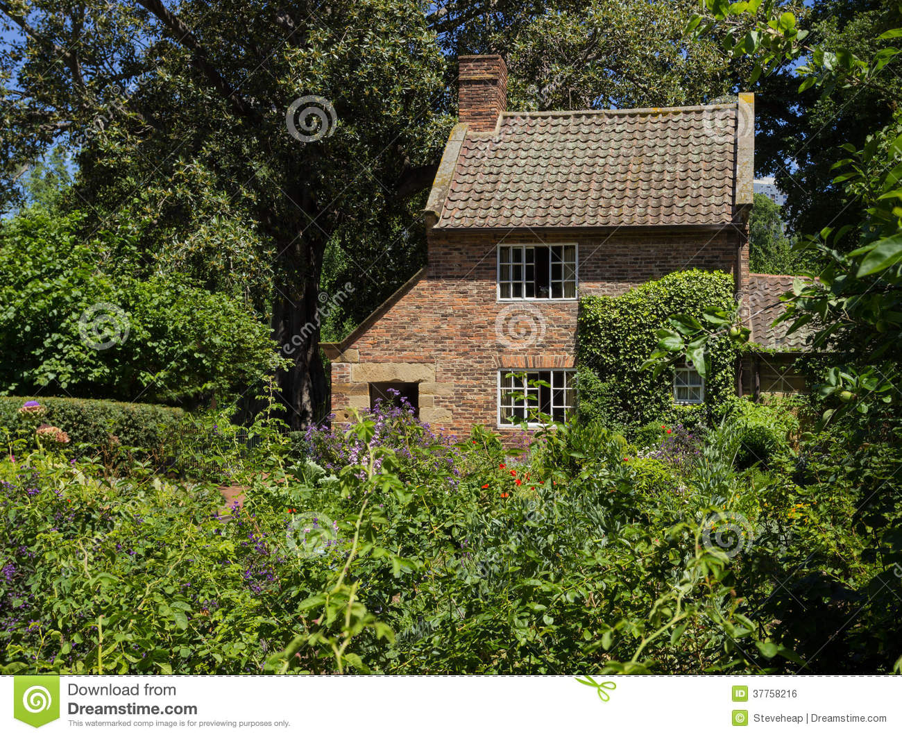 Cottage Garden Of Small Brick Home Stock Photo - Image of small ... for Small Brick Farmhouse  157uhy