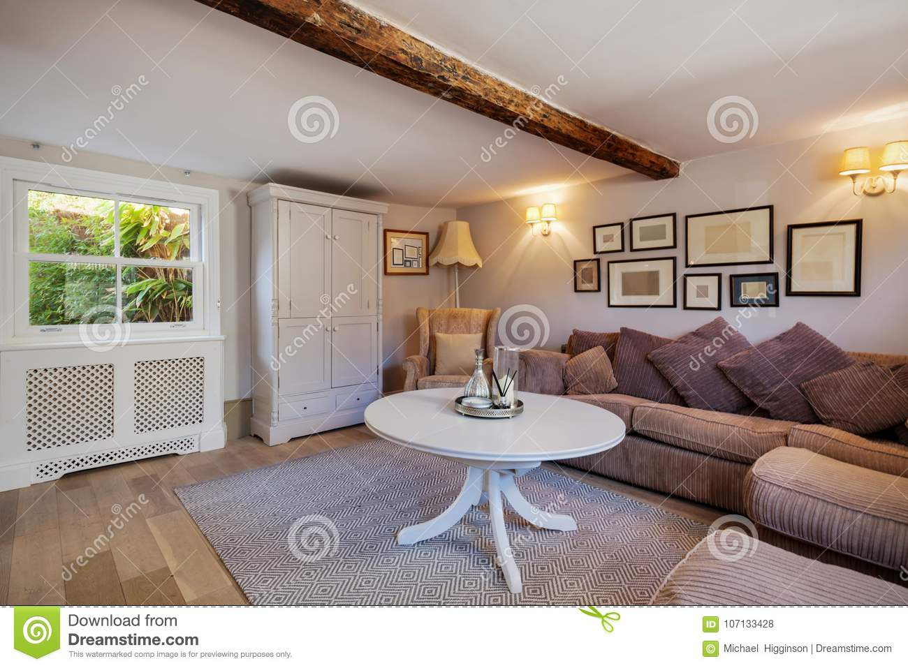 Cottage Living Room With Sofas And Picture Frames Stock ...
