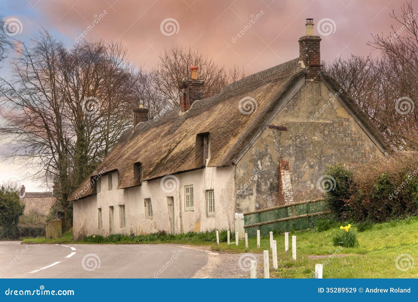 Cottage ricoperto di paglia dorset immagine stock for Vecchio cottage inglese