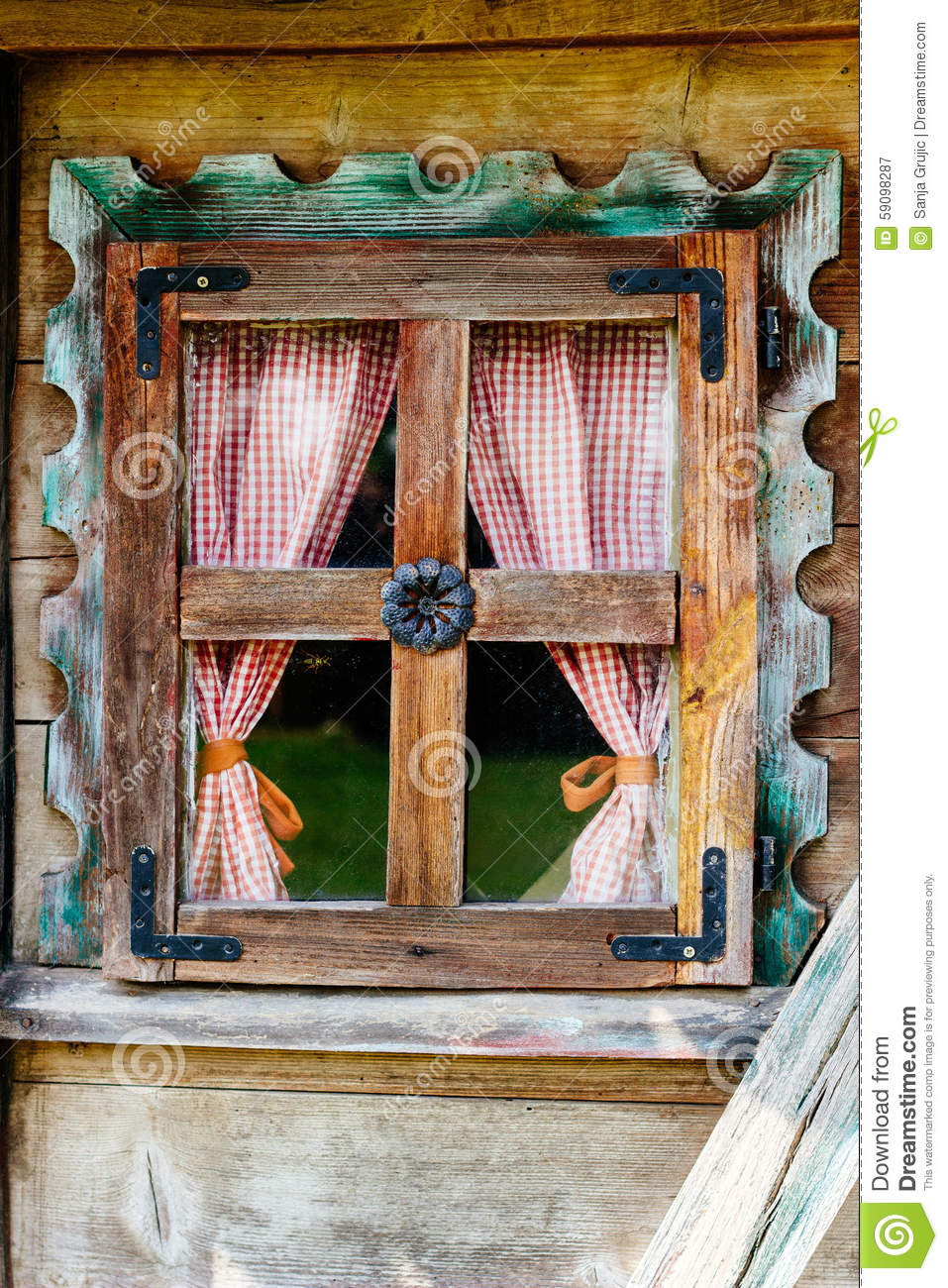 cottage window with curtains stock photo