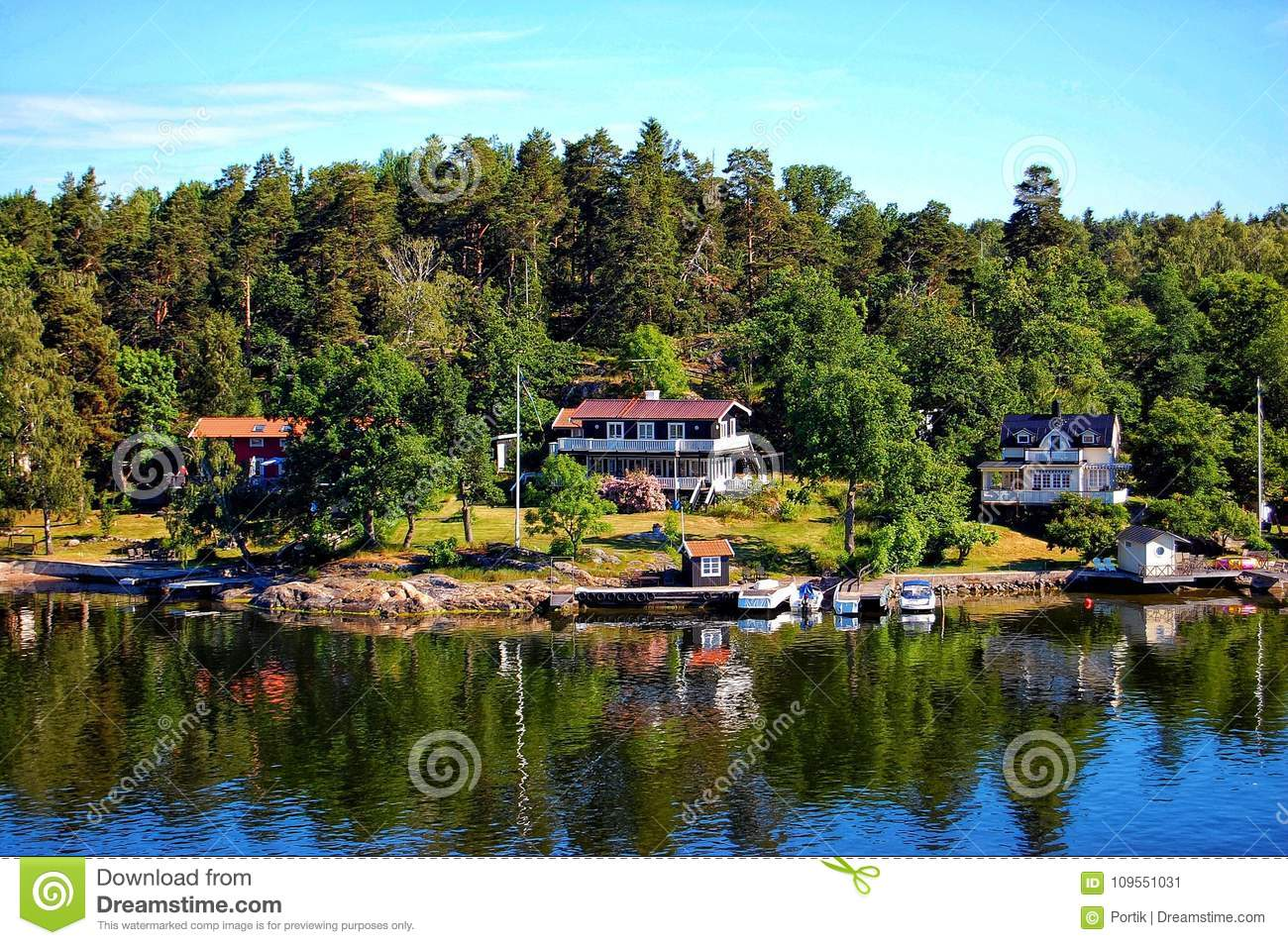 Cottages On River Bank In Woods European Places Stock Image