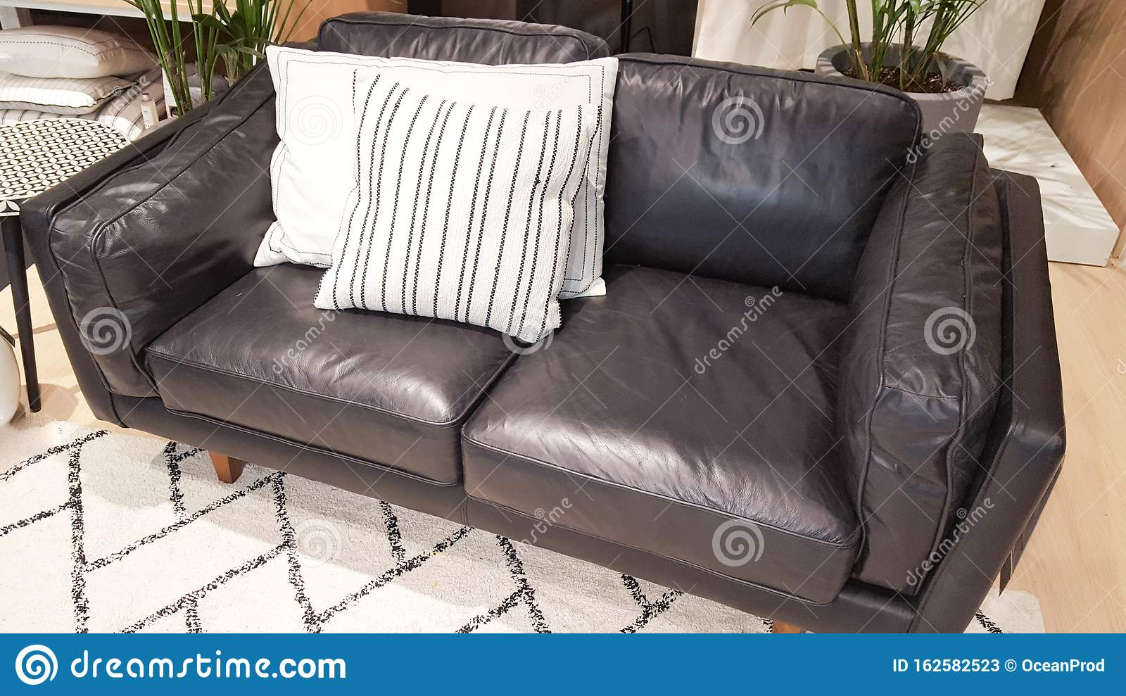 Picture of: Couch Black Living Room With Leather Sofa With Beige Fashion Cushion Carpet At Home House Stock Image Image Of Chair House 162582523