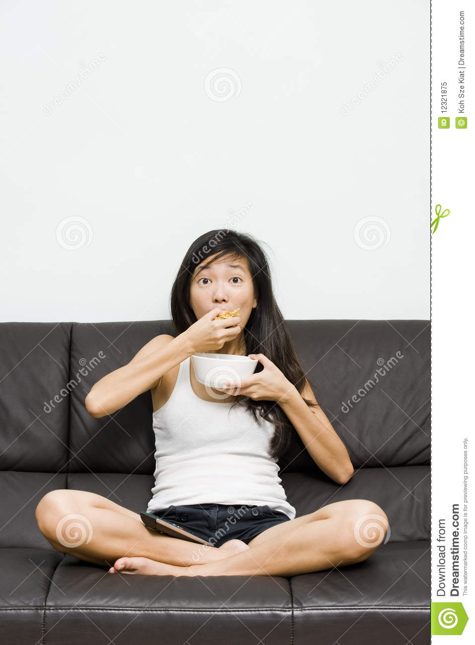 Couch Potato Eating And Watching Television Stock Image