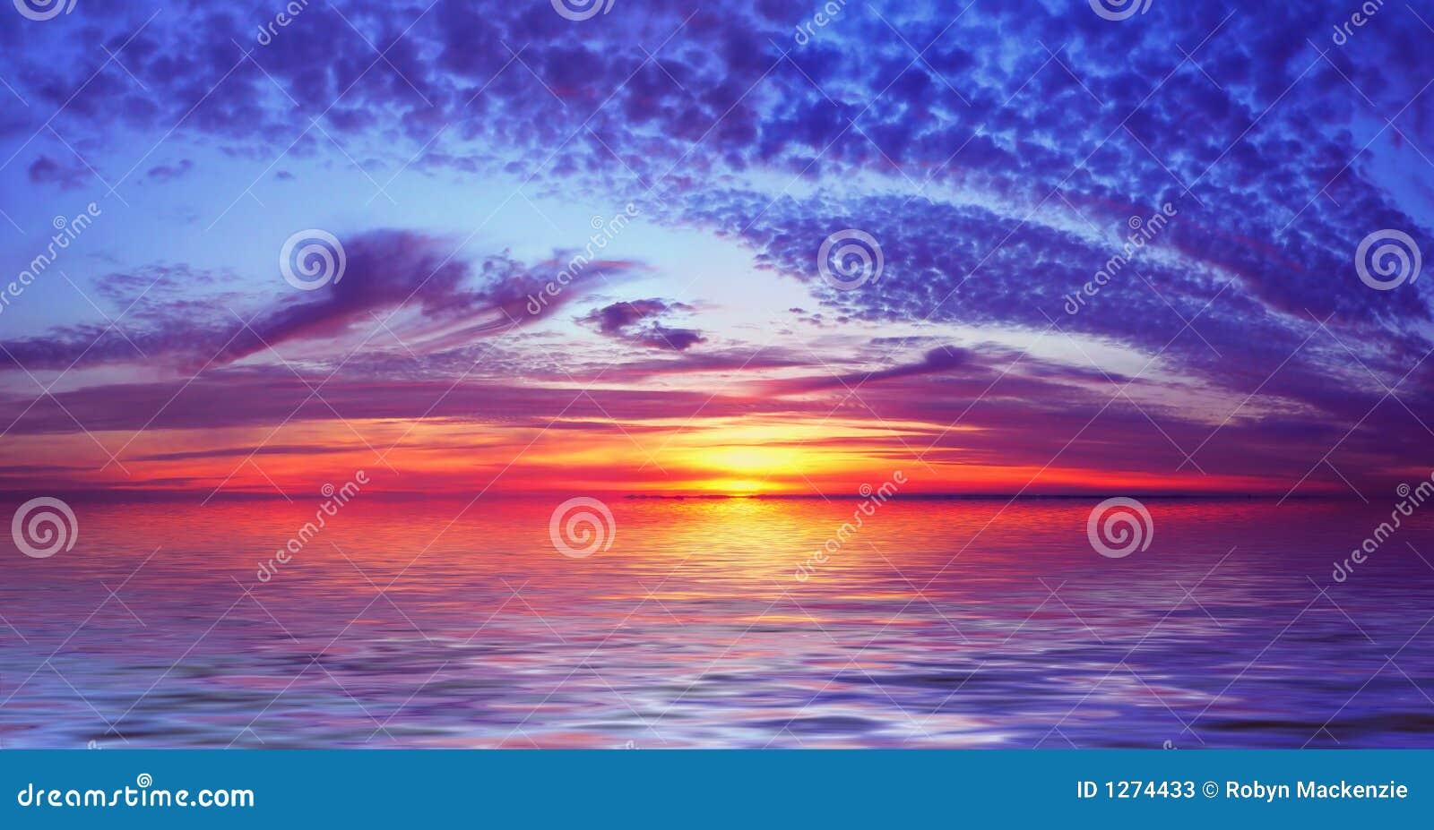 Coucher du soleil de plage de compartiment